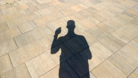 The shadow of a man shows gesture Footage
