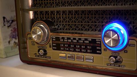 Adjusting the volume knob of the retro radio Footage