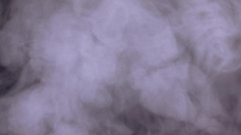 Abstract white water vapor on black background Live Action