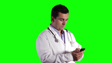 Young Doctor Smartphone Texting Greenscreen 9 Footage
