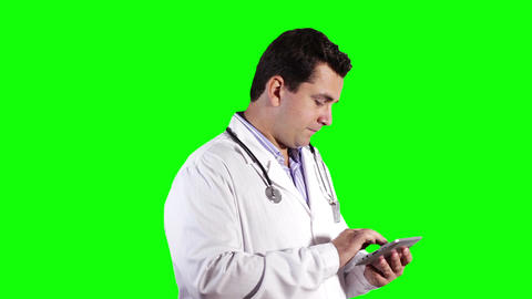 Young Doctor Tablet PC Greenscreen 13 Stock Video Footage