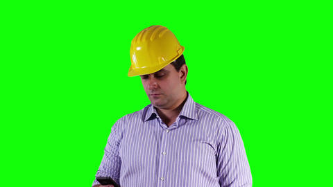 Young Engineer Cell Phone Greenscreen 6 Stock Video Footage