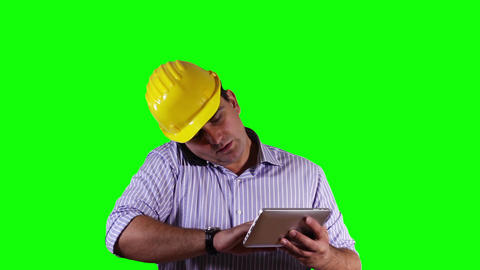 Young Engineer Tablet PC Cell Phone Greenscreen 18 Stock Video Footage