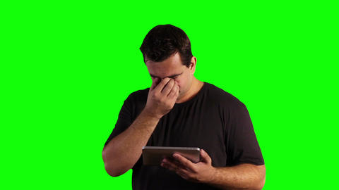 Young Man Tablet PC Bad News Greenscreen 11 Stock Video Footage