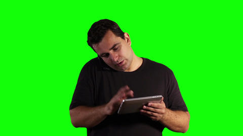 Young Man Tablet PC Cell Phone Greenscreen 17 Stock Video Footage