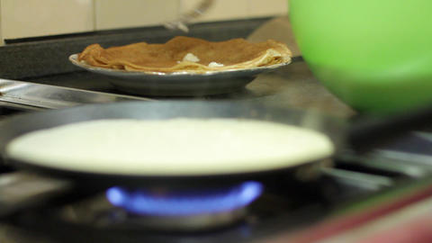 Preparation Of Pancakes On Frying Pan stock footage