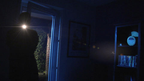 burglar comes in watch around with torch 10843 Footage