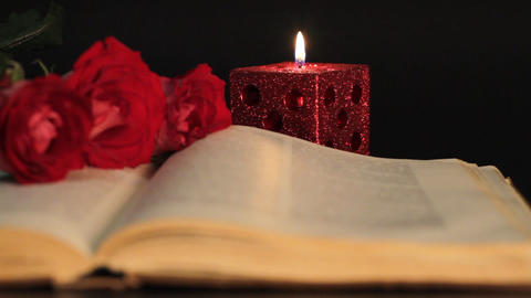 book, candle and red roses Footage