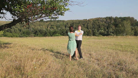 Man and woman dancing in the field Stock Video Footage