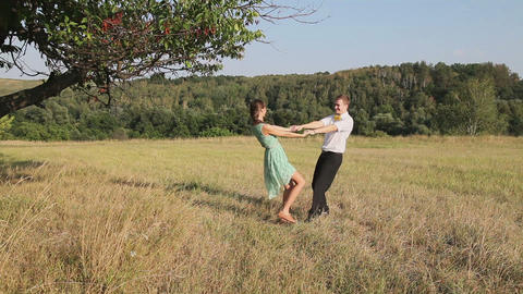 Man and woman dancing in the field Footage