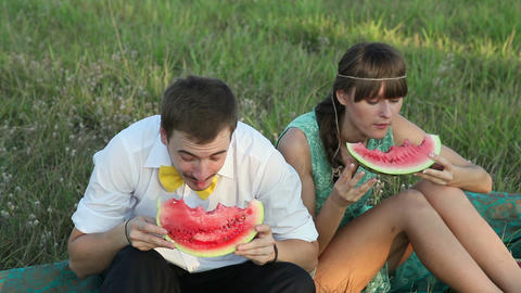 Young Couple Eating Watermelon At Picnic stock footage