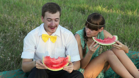Young couple eating watermelon at picnic Stock Video Footage