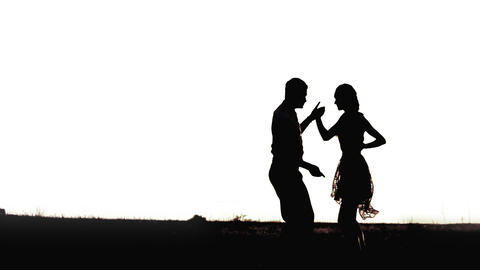 Young black couple silhouettes dancing isolated on white background Footage