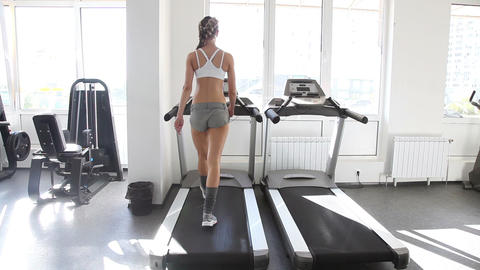 Athletic woman running on the track in gym Stock Video Footage