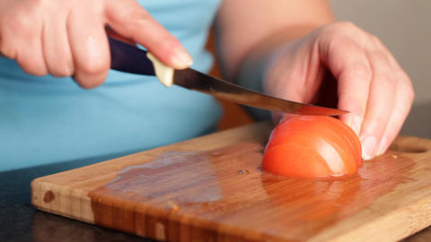 Cutting of tomato for salad Footage