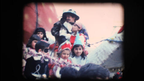 Vintage 8mm. Children in costume riding a float Stock Video Footage
