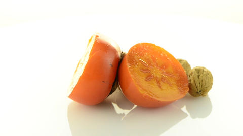 Ripe persimmon and nuts Stock Video Footage