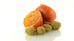 Ripe persimmon and nuts Footage