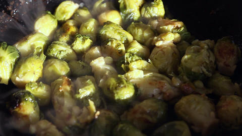Fried brussels sprouts on a frying-pan Stock Video Footage