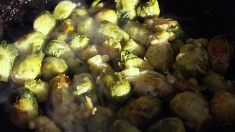Fried brussels sprouts on a frying-pan Footage