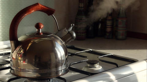 Simmering whistling kettle on the stove Stock Video Footage