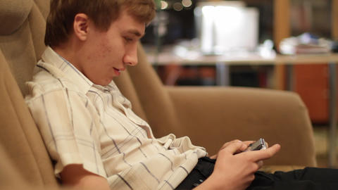 teenager plays game Footage