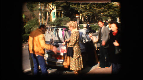 Vintage 8mm. People passing through a market Stock Video Footage