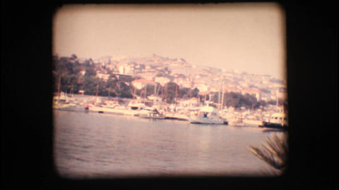Vintage 8mm. View of port and sail boats Stock Video Footage