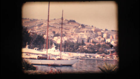 Vintage 8mm. View Of Port And Sail Boats stock footage