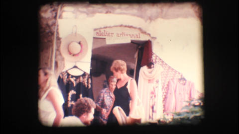 Vintage 8mm. People in and out of a little shop Footage