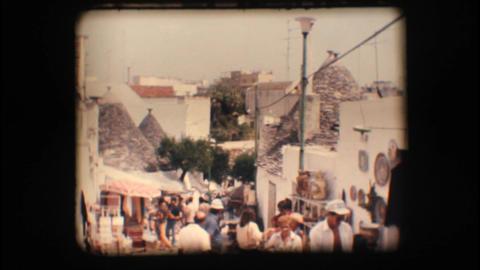 Vintage 8mm. Souvenir shops in Alberobello Stock Video Footage