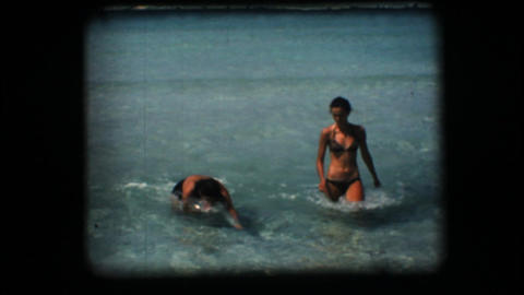 Vintage 8mm. Two women coming out of the sea Stock Video Footage