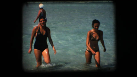 Vintage 8mm. Two women coming out of the sea Footage