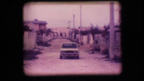 Vintage 8mm. Car driving up a road Stock Video Footage