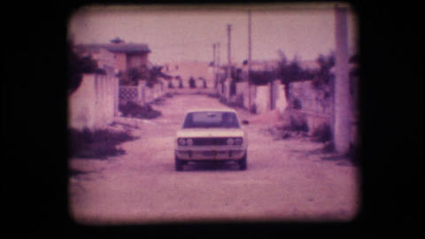 Vintage 8mm. Car driving up a road Footage