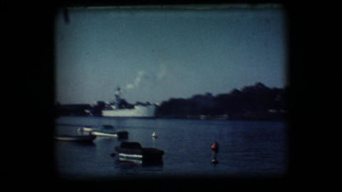 Vintage 8mm. Docked War Ship stock footage