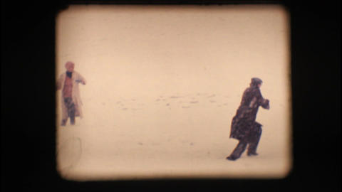 Vintage 8mm. Friends playing with snow – Slow mo Stock Video Footage