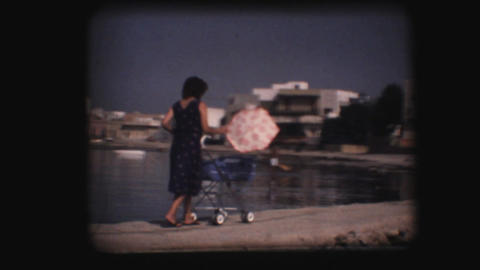 Vintage 8mm. Woman pushing stroller Footage