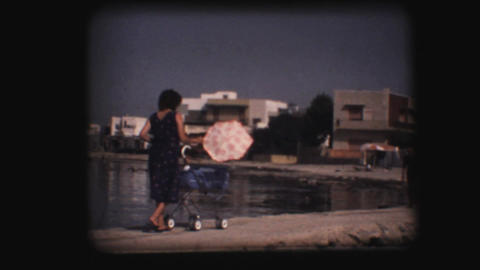 Vintage 8mm. Woman pushing stroller Stock Video Footage