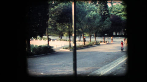 Vintage 8mm. Sunny park with children playing Stock Video Footage