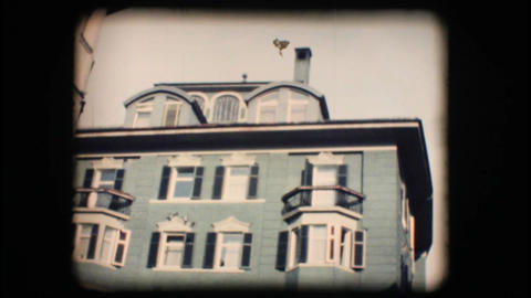 Vintage 8mm. Building with fresco wall painting Stock Video Footage
