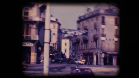 Vintage 8mm. Busy street and statue Stock Video Footage