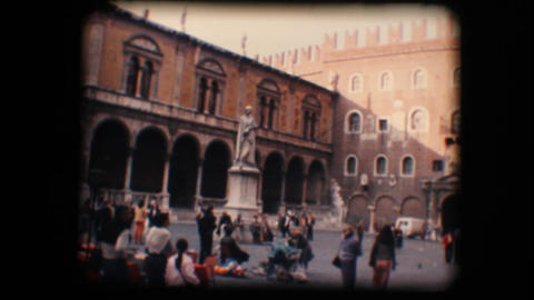 Vintage 8mm. Tourists walking around in town plaza Stock Video Footage