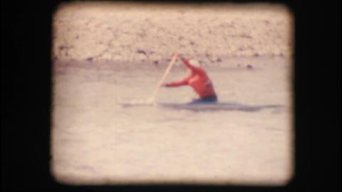 Vintage 8mm. Man kayaking down the Adige river Stock Video Footage