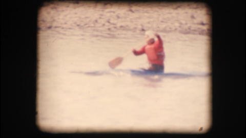 Vintage 8mm. Man kayaking down the Adige river Footage
