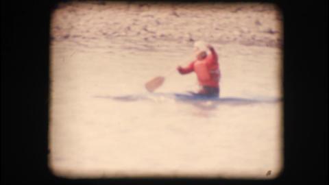 Vintage 8mm. Man kayaking down the Adige river Footage