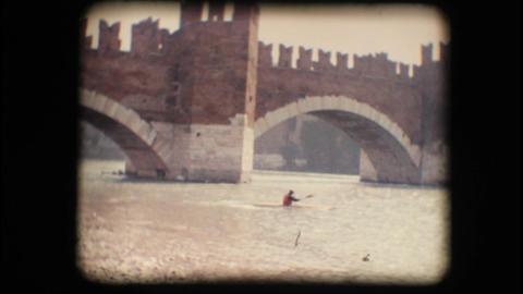 Vintage 8mm. Man kayaking against the current Footage