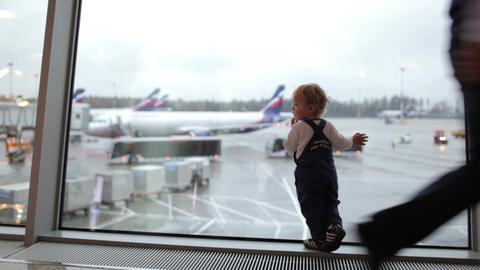 Kid near the window in the airport Stock Video Footage