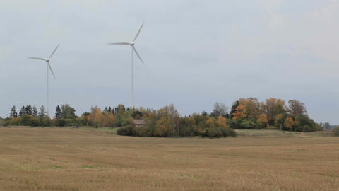 Two wind turbines in the field. Green energy Footage