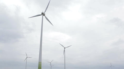 A lot of windmills on the sky background Stock Video Footage